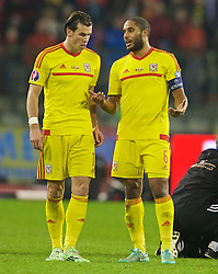 BRUSSELS, BELGIUM - Sunday, November 16, 2014: Wales' Gareth Bale and captain Ashley Williams during the UEFA Euro 2016 Qualifying Group B game against Belgium at the King Baudouin [Heysel] Stadium. (Pic by David Rawcliffe/Propaganda)