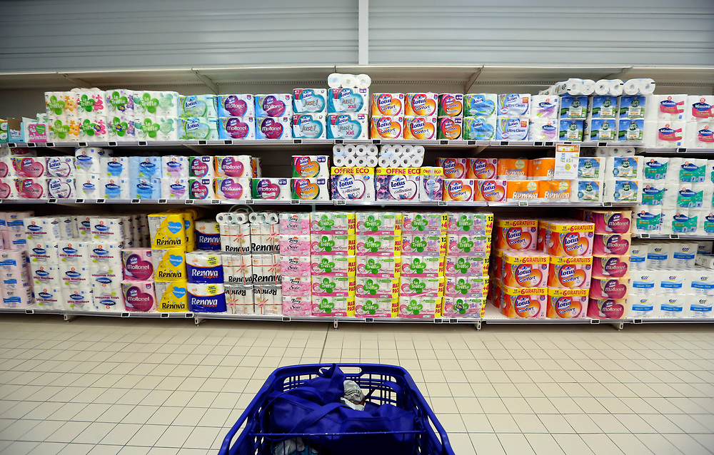 23 March 2020. Montreuil Sur Mer, Pas de Calais, France. <br /> Coronavirus - COVID-19 in Northern France.<br /> <br /> An abundant supply of toilet rolls fill shelves at Leclerc supermarket in Attin near Montreuil Sur Mer. Local supermarkets for the most part have not been plagued by people over-shopping  and hoarding goods. <br /> <br /> Numbers entering the store at any one time are restricted to try and maintain 'social distancing,' in an effort to halt the spread of the virus. Anyone leaving their home must carry with them an 'attestation,' in a effect a self administered permit to allow them out of the house. If stopped by the police, one must produce a valid permit along with identification papers. Failure to do so is punishable with heavy fines. Movement in France has been heavily restricted by the government.<br /> <br /> Montreuil Sur Mer was the headquarters of the British Army under Field-Marshal Sir Douglas Haig from March 1916 to April 1919. Over 1,200 year old, the ancient fortified  town with its high ramparts has endured through history, surviving the plague and King Henry VIII's invasion of France in 1544 when the Duke of Norfolk under Henry VIII's command laid a disastrous siege to the town which held firm until Norfolk was forced to withdraw in 1545. Residents are confident the ancient town can survive the coronavirus too. <br /> Photo©; Charlie Varley/varleypix.com