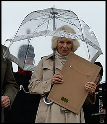 The Duchess of Cornwall has trouble with her umbrella  during a tour of the Royal Bath & West Show, Royal Bath & West Showground, Shepton Mallet, Somerset, United Kingdom, Wednesday, 28th May 2014. Picture by Andrew Parsons / i-Images