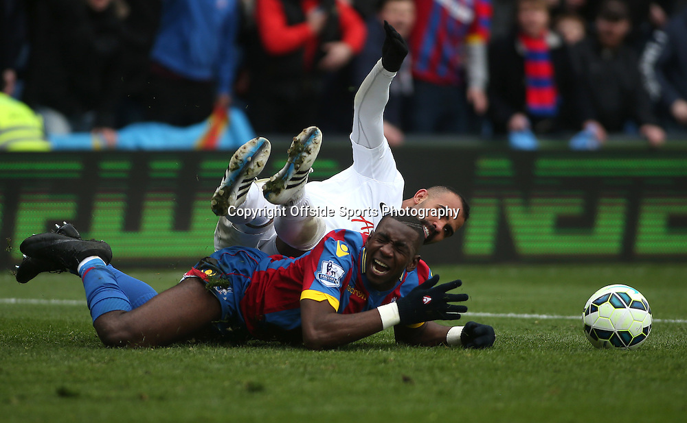 14 March 2015 - Barclays Premier League - Crystal Palace v Queens Park Rangers - Sandro of QPR fouls Yannick Bolasie of Palace.<br /> <br /> Photo: Ryan Smyth/Offside