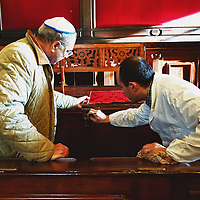 VENICE, ITALY - NOVEMBER 15:  Mr Corrado Calimani the Vice President of the Jewish Comminity of Venice shows to an artisan a small desk that needs restoration inside the Levantine Synagogue established in 1538 on November 15, 2011 in Venice, Italy. Established in 1516 the Ghetto of Venice was the area were Jews were compelled to live during the Venetian Republic. The English term 'ghetto' is derived from the Venetian term for 'slag' and refers to the refuse left the foundry that was located on the same island. In present times the ghetto is a multi-ethnical area area seen as the cultural heart of the city, but with five synagogues remains the centre of the of Jewish community.