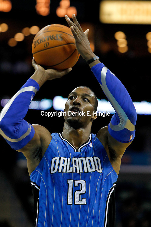 January 27, 2012; New Orleans, LA, USA; Orlando Magic center Dwight Howard (12) shoots a free throw against the New Orleans Hornets during the second half of a game at the New Orleans Arena. The Hornets defeated the Magic 93-67.  Mandatory Credit: Derick E. Hingle-US PRESSWIRE