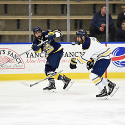 BUFFALO, NY - SEP 19,  2017: Ontario Junior Hockey League Governors Showcase game between the Buffalo Jr. Sabres and the Whitby Fury, Austin Ramirez #16 of the Whitby Fury clears the puck during the third period.<br /> (Photo by Andy Corneau / OJHL Images)