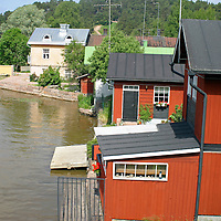 Europe, Scandinavia, Finland, Porvoo. Wooden storehouses line the Porvoonjoki river in scenic Porvoo.