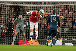 19.02.2014, Emirates Stadion, London, ENG, UEFA CL, FC Arsenal vs FC Bayern Muenchen, Achtelfinale, im Bild Laurent Koscielny (Arsenal FC #6) im Kopfballduell gegen Arjen Robben (FC Bayern Muenchen #10), Aktion, Action // during the UEFA Champions League Round of 16 match between FC Arsenal and FC Bayern Munich at the Emirates Stadion in London, Great Britain on 2014/02/19. EXPA Pictures © 2014, PhotoCredit: EXPA/ Eibner-Pressefoto/ Schueler<br /> <br /> *****ATTENTION - OUT of GER*****