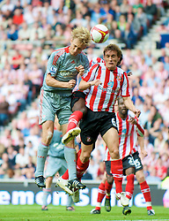 SUNDERLAND, ENGLAND - Saturday, August 16, 2008: Liverpool's Sami Hyypia and Sunderland's Dean Whitehead during the opening Premiership match of the season at the Stadium of Light. (Photo by David Rawcliffe/Propaganda)
