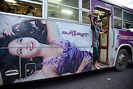YANGON, MYANMAR - SEPTEMBER 23, 2012.Modern advertisement is seen on a bus in Yangon, Myanmar on Sep 23, 2012..After nearly five decades where the military had tight control over people's lives, the arrival of democracy has led to debates about a new national identity for the country..(Photo by Kuni Takahashi)..