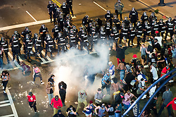 September 21, 2016 - Charlotte, North Carolina, U.S. - Protestors confront police along Trade Street during a protest and eventual riot uptown. This is the second day of violence that erupted after a police officer's fatal shooting of an African-American man Tuesday afternoon. (Credit Image: © Sean Meyers via ZUMA Wire)