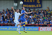 Bolton Wanderers striker Gary Madine (14) and AFC Wimbledon defender Sean Kelly (22) during the EFL Sky Bet League 1 match between AFC Wimbledon and Bolton Wanderers at the Cherry Red Records Stadium, Kingston, England on 13 August 2016. Photo by Stuart Butcher.