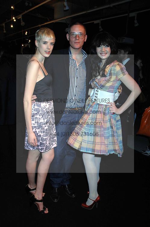 Left to right, model AGYNESS DEYN, GILES DEACON and DAISY LOWE at the launch of his Gold range for New Look held at their store 500 Oxford Street, London W1 on 12th March 2006.<br />