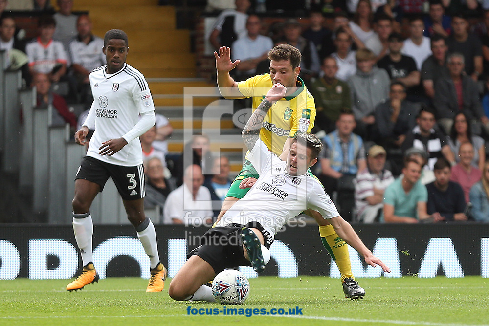 Yanic Wildschut of Norwich and Oliver Norwood of Fulham in action during the Sky Bet Championship match at Craven Cottage, London<br /> Picture by Paul Chesterton/Focus Images Ltd +44 7904 640267<br /> 05/08/2017