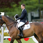 NORTH SALEM, NEW YORK - May 15: McLain Ward, USA, riding HH Carlos Z after winning The $50,000 Old Salem Farm Grand Prix presented by The Kincade Group at the Old Salem Farm Spring Horse Show on May 15, 2016 in North Salem. (Photo by Tim Clayton/Corbis via Getty Images)
