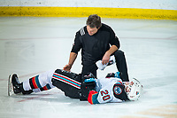 KELOWNA, BC - DECEMBER 30:  Athletic therapist Scott Hoyer checks out Matthew Wedman #20 of the Kelowna Rockets as he lies on the ice after a collision with a player of the Prince George Cougars at Prospera Place on December 30, 2019 in Kelowna, Canada. (Photo by Marissa Baecker/Shoot the Breeze)
