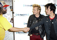 Green Day visits the studios of SiriusXM and meets Judah Friedlander on September 14, 2012 .L to R ; Judah Friedlander ,Tre Cool, and Billie Joe Armstrong.