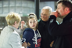 © Licensed to London News Pictures . FILE PICTURE DATED 23/05/2017 as Manchester prepares to mark a year since the Manchester Arena terror attack . Manchester, UK. EMILIA SENIOR (2nd left) is brought to a police cordon from the Arena where she is greeted by relatives . Anxious parents wait by the police cordon for news of children inside the Manchester Arena . Police and other emergency services are seen near the Manchester Arena after Salman Abedi murdered 22 and injured dozens more at an Ariana Grande concert at Manchester Arena. Photo credit : Joel Goodman/LNP