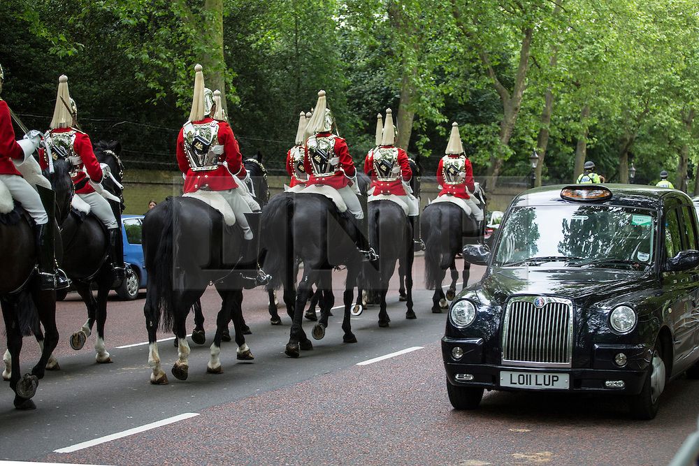 © licensed to London News Pictures. London, UK 10/06/2013. The King's Troop Royal Horse Artillery marching to Green Park in London before firing a 41 gun salute in honour of the Duke of Edinburgh's 92nd birthday. Photo credit: Tolga Akmen/LNP
