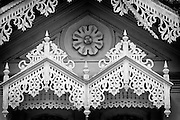 A4.<br /> Intricate wood detailing on windows of an old house in the town of Seenigama, near Galle. The structures over the windows are used to keep driving rain out.