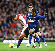 Picture by Andrew Tobin/Focus Images Ltd. 07710 761829. .21/01/12. Luis Antonio Valencia (25) of Manchester United tangles with Robin van Persie (10) of Arsenal during the Barclays Premier League match between Arsenal and Manchester United at Emirates Stadium, London.