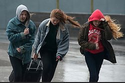 Christmas Storm Weather. Pedestrians struggle to walk in heavy rain and strong wind at King's Cross Station, London. Kings Cross, London, United Kingdom. Monday, 23rd December 2013. Picture by Peter Kollanyi / i-Images