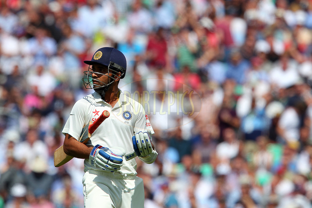 Ajinkya Rahane of India departs during day one of the fifth Investec Test Match between England and India held at The Kia Oval cricket ground in London, England on the 15th August 2014<br /> <br /> Photo by Ron Gaunt / SPORTZPICS/ BCCI