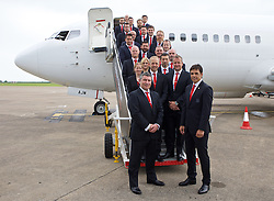 CARDIFF, WALES - Saturday, June 4, 2016:  Wales Manager Chris Coleman poses with his team of staff on the steps of the aircraft after the squad is given a send off at Cardiff Airport as the squad head to Sweden for their last friendly before the UEFA Euro 2016 in France. Chris Senior, Paul Harris, Dave Rowe, Jamie Benito Plans, Rhodri Martin, Ronan Kavanagh, David Weeks, Ian Gwyn Hughes, James Turner, Mark Evans, Adam Owen, David Griffiths, Jon Houghton, Sean Connelly, Kevin McKusker, Ian Mitchell, Suzanne Twamley, Paul Trollope, Martyn Margetson, Esther Laugharne, Osian Roberts, Chris Coleman. (Picl by Paul Greenwood/Propaganda)