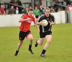 Tourmakeady's  Kevin Dolan gets past Ballyhaunis Enda Griffin during their Intermediate Championship clash on sunday.<br /> Pic Conor McKeown