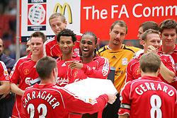 CARDIFF, WALES - SUNDAY, AUGUST 13th, 2006: Liverpool's Jamie Carragher and Steven Gerrard lift up the trophy as Florent Sinama-Pongolle laughs after the Community Shield match against Chelsea at the Millennium Stadium. (Pic by David Rawcliffe/Propaganda)
