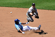 July 1, 2009:  Shortstop Nick Punto #8 of the Minnesota Twins completes a double play with a throw over a sliding Jose Guillen #11 of the Kansas City Royals ending the sixth inning at Kauffman Stadium in Kansas City, Missouri.  ..