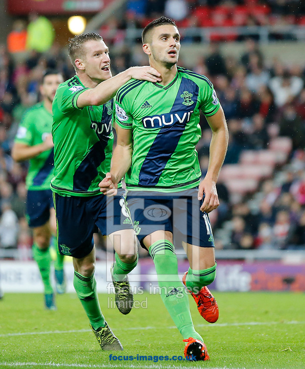Dusan Tadic (r) of Southampton celebrates scoring the opening goal with Steven Davis during the Barclays Premier League match at the Stadium Of Light, Sunderland<br /> Picture by Simon Moore/Focus Images Ltd 07807 671782<br /> 07/11/2015