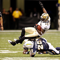 August 27, 2010; New Orleans, LA, USA; New Orleans Saints wide receiver Courtney Roby (15) is upended by San Diego Chargers safety Darrell Stuckey (25)  during the second half of a preseason game at the Louisiana Superdome. The New Orleans Saints defeated the San Diego Chargers 36-21. Mandatory Credit: Derick E. Hingle