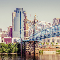 Panoramic Cincinnati skyline retro photo with John A. Roebling bridge, and downtown city office buildings including Great American Insurance Group Tower, Omnicare building, Scripps Center building, PNC Tower Building, Carew Tower, US Bank Building, and Fifth Third Bank building. Photo panoramic ratio is 1:3 and has a vintage retro tone.