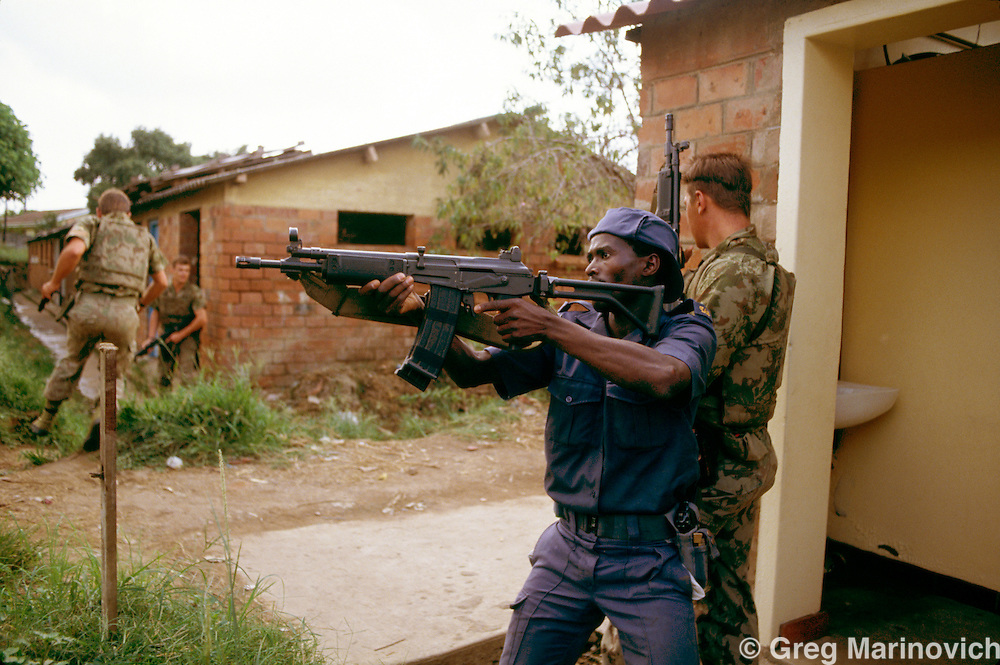 Umlazi, KwaZulu Natal, 1995: Riot policemen go house to house during IFP - ANC violence in KwaMashu townhip outside Durban after the first non racial elections.