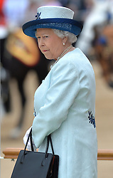 Image ©Licensed to i-Images Picture Agency. 14/06/2014. <br /> <br /> The Queen takes her position at Horse Guards Parade during the Trooping of the Colour.<br /> <br /> Trooping The Colour, Her Majesty The Queens Birthday Parade at Horse Guards Parade, London, UK.<br /> <br /> Saturday 14th of June 2014.<br /> Picture by Ben Stevens / i-Images
