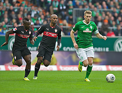 15.03.2014, Weserstadion, Bremen, GER, 1. FBL, SV Werder Bremen vs VfB Stuttgart, 25. Runde, im Bild Aaron Hunt (Bremen #14) am Ball, verfolgt von Arthur Boka (VfB Stuttgart #15), Cacau (VfB Stuttgart #18) // Aaron Hunt (Bremen #14) am Ball, verfolgt von Arthur Boka (VfB Stuttgart #15), Cacau (VfB Stuttgart #18) during the German Bundesliga 25th round match between SV Werder Bremen and VfB Stuttgart at the Weserstadion in Bremen, Germany on 2014/03/16. EXPA Pictures © 2014, PhotoCredit: EXPA/ Andreas Gumz<br /> <br /> *****ATTENTION - OUT of GER*****
