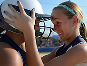 R.J. Swanson, right, encourages with her Edge Chaos (Plainfield, Ill.) teammate Gabby Schultz just before their team defeated the Lady Lasers Purple (Mount Gilead, Ohio) at Green Valley Sports Complex in Moline on Wednesday, August 1, 2012.
