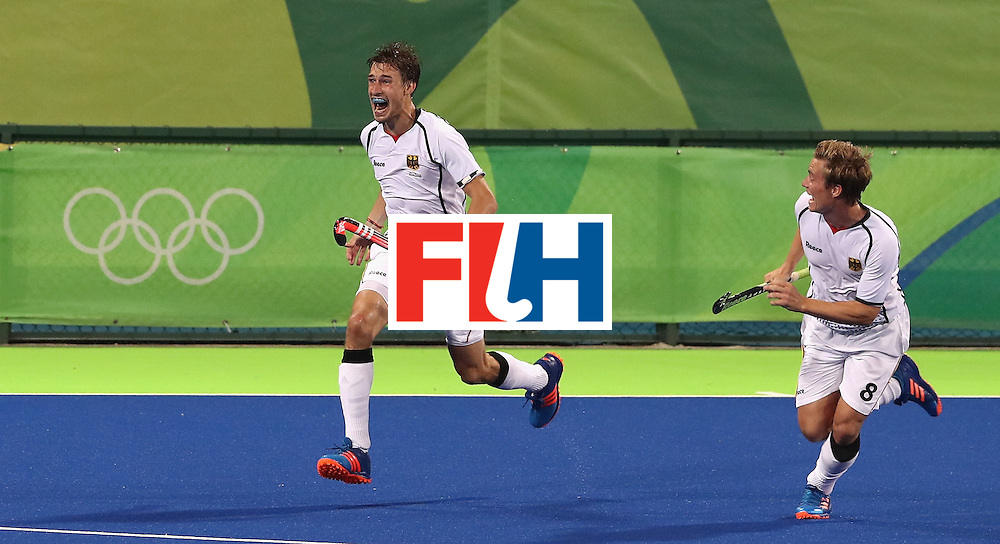 RIO DE JANEIRO, BRAZIL - AUGUST 14:  Florian Fuchs (L) of Germany celebrates with team mate Mats Grambusch after scoring the match winning last second goal during the Men's hockey quarter final match between the Germany and New Zealand on Day 9 of the Rio 2016 Olympic Games at the Olympic Hockey Centre on August 14, 2016 in Rio de Janeiro, Brazil.  (Photo by David Rogers/Getty Images)