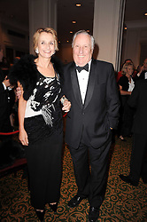 Author FREDERICK FORSYTH and his wife SANDY at a gala dinner in celebration of 80 years since the first Foyles Literary Luncheon, held in The Ball Room, Grosvenor House Hotel, Park Lane, London on 21st October 2010.