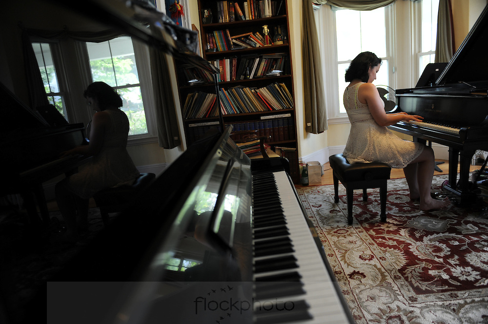"""14-year-old Anna Larsen practices the piano at her home in Needham, Friday, June 19, 2015. She has appeared on Oprah, played at Carnegie Hall, won NPR's """"From the Top"""" award, and is now returning from concerts in China, Russia and England.  She has been selected as one of 24 teens worldwide to compete in the Van Cliburn international competition, which happens once every four years."""