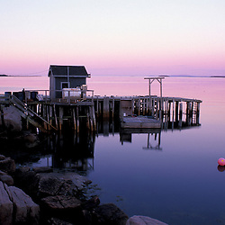 Great Wass Island, ME.  The pier in Black Duck Cove on the coast of Great Wass Island in Down East Maine.  Part of U. Maine Machias lobster and clam hatchery.  Sunrise.