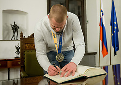 Matej Gaber signing the City of Ljubljana's Golden Book during reception of Slovenian National Handball Men team after they placed third at IHF World Handball Championship France 2017, on January 30, 2017 in City hall, Ljubljana centre, Slovenia. Photo by Vid Ponikvar / Sportida