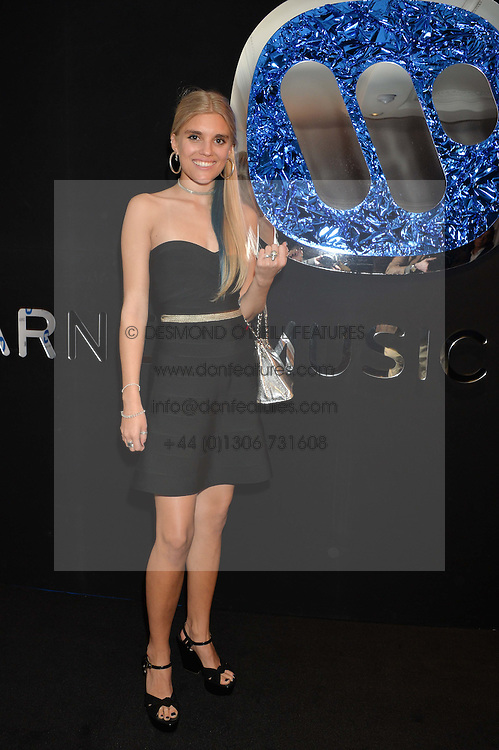 TIGERLILY TAYLOR at the Warner Music Group & Belvedere BRIT Awards After Party held at The Savoy, London on 19th February 2014.