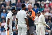 Cheteshwar Pujara of India is checked over by the team doctor after being hit on the helmet by the ball from Ben Stokes of England during day two of the fourth SpecSavers International Test Match 2018 match between England and India at the Ageas Bowl, Southampton, United Kingdom on 31 August 2018.