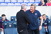 Bolton Wanderers (interim) manager Jimmy Phillips and Ipswich Town manager Paul Lambert shaking hands before  the EFL Sky Bet League 1 match between Bolton Wanderers and Ipswich Town at the University of  Bolton Stadium, Bolton, England on 24 August 2019.
