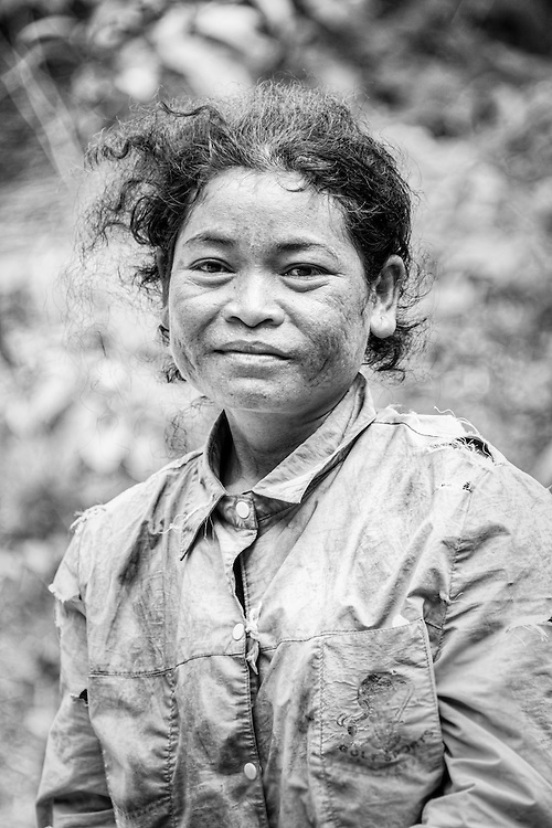 A charcoal worker in rural Cambodia. Workers collect wood from diminishing forests of Cambodia and burn them in kilns earning less than a dollar a day.