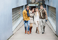 Full length of young friends on walkway