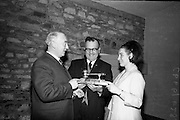 24/05/1966<br /> 05/24/1966<br /> 24 May 1966<br /> Players and Wills trophies presented for Gaelic League Inter Branch Debating Competition. Mr. P.J. Lavery, Director of Player and Wills (Ireland) Ltd. handed over a set of solid silver trophies and cheques to Cathal Ó Feinneadha, Uachtarain, Conradh na Gaeilge, for an All Ireland gaelic League Inter-Branch Debating Competition The presentation took place at the new Conradh na Gaeilge headwaters at Harcourt Street, Dublin. Picture shows (l-r):  Mr. Lavery; Donncha O'Sulleabhain, Ard Runai, Conradh na Gaeilge and Maire Ni Maolain, (Galway) Runai na hArd Chraoibhe, viewing the major silver trophy.