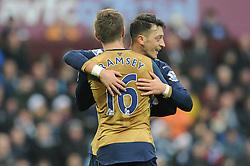 Aaron Ramsey of Arsenal celebrates with Mesut Ozil of Arsenal who set up the goal - Mandatory byline: Dougie Allward/JMP - 13/12/2015 - Football - Villa Park - Birmingham, England - Aston Villa v Arsenal - Barclays Premier League
