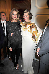 Left to right, NATALIA VODIANOVA and MILLA JOVAVICH  at the 3rd Fortune Forum Summit held at The Dorchester Hotel, Park Lane, London on 3rd March 2009.