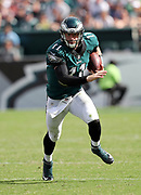 Philadelphia Eagles quarterback Carson Wentz (11) scrambles and runs for a short gain in the fourth quarter during the 2016 NFL week 1 regular season football game against the Cleveland Browns on Sunday, Sept. 11, 2016 in Philadelphia. The Eagles won the game 29-10. (©Paul Anthony Spinelli)