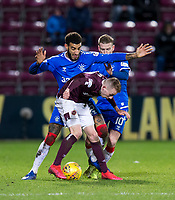 Football - 2019 / 2020 William Hill Scottish Cup - Quarter-Final: Heart of Midlothian vs. Rangers<br /> <br /> Lewis Moore of Hearts vies with Connor Goldson of Rangers, at Tynecastle Park, Edinburgh.<br /> <br /> COLORSPORT/BRUCE WHITE